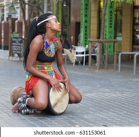 Street Performer in Greenmarket Square, Cape Town, South Africa earning money from passing tourists to the city on 28 April 2017