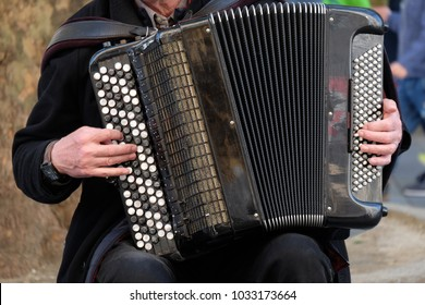 Street performer playing Classic muscal instrument, accordian
