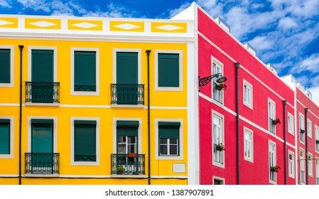 Street perspective view with colorful traditional houses. Lisbon, Portugal. Colorful buildings of Lisbon historic center, Portugal. Street with colorful houses in Lisbon, Portugal.