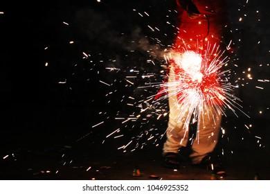 Street Photography during Diwali A candid shot of a man holding a firecracker in his hand.