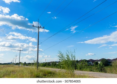 Street poles and power lines Background sky