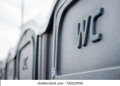 Street portable toilets in a row. Selective focus. Close-up.