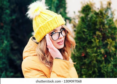 Street portrait of beautiful young fashionable woman with glasses. Lady wearing stylish winter clothes. Model looking aside. Female fashion. Close up