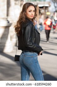 Street portrait of beautiful young fashionable brunette woman.