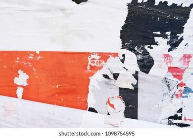 Street poster art a kind of graffiti, old weathered torn street billboard  advertising
