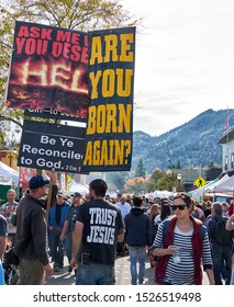 Street preachers carring signs to repent. Salmon Days celebration Issquah, Washington. October, 6, 2019.