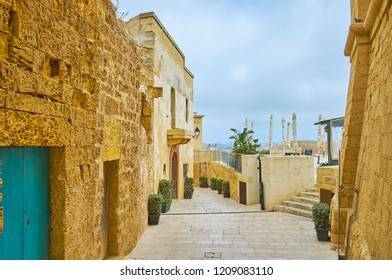 The street with preserved medieval edifices and outdoor cafe on rampart in Rabat Citadel, Victoria, Gozo Island, Malta.