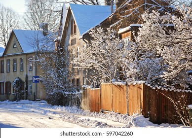 Street with private houses covered by snow
