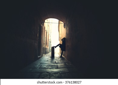 street prostitute in a dark alley waiting for clients