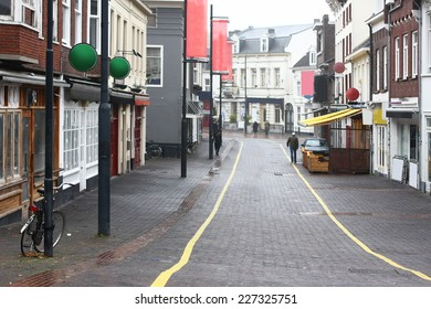 street with pubs and bars with yellow line on road surface