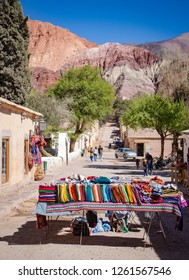 Street of Purmamarca town with traditional handicraft clothing, Argentina, Quebrada de Humahuaca, Argentina
