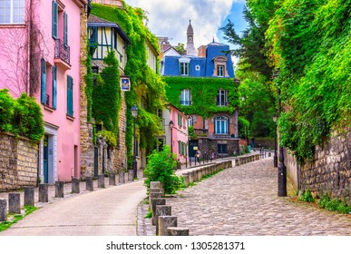 Street in quarter Montmartre in Paris, France. Cozy cityscape of Paris. Architecture and landmarks of Paris.