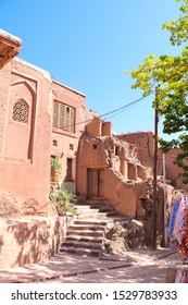 The street with red adobe houses in mountain Abyaneh village, which is the oldest Iranian traditional village in central part of Iran. UNESCO world heritage site
