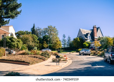 Street in the residential area of Oakland on a sunny autumn day, San Francisco bay area, California