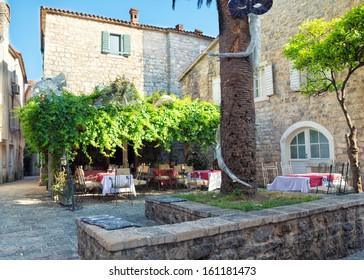 Street restaurant in old town of Budva, Montenegro