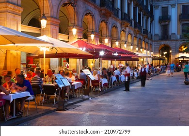 Street restaurants at Placa Reial in summer night. Barcelona, Spain