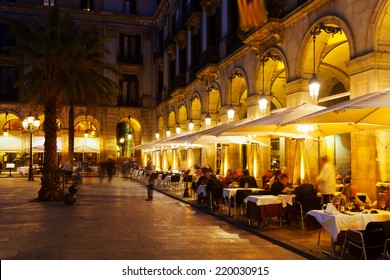 Street restaurants at Placa Reial in winter evening. Barcelona, Spain