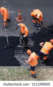 Street resurfacing. Fresh asphalt construction. Bad road