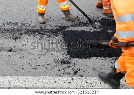 Street resurfacing. Fresh asphalt construction. Bad road