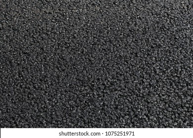 Street resurfacing - fresh asphalt road construction blacktop.