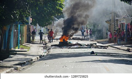 Street riots in small town in Samana Peninsula, Domminican Republic - 13th January 2018. Strike with fire and people on the street. Burning tire.