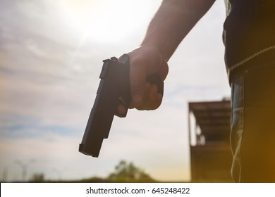 Street Robber holds arms