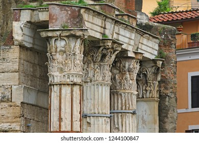 A street in Rome, Italy with ancient Roman columns in the Forum of Augustus showing remains of the temple Mars Ultor from 2BC in the Corinthian style of architecture