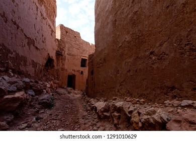 Street with ruined kasbahs, traditional berber houses made from clay, Morocco