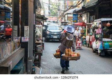 a street saler at Pratunam in the city of Bangkok in Thailand in Southeastasia.  Thailand, Bangkok, November, 2018