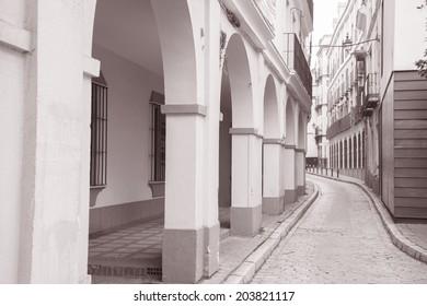 Street in Santa Cruz Neighbourhood; Seville - Sevilla; Spain in Black and White Sepia Tone