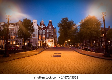 Street scene in Amsterdam at night with lights and architecture