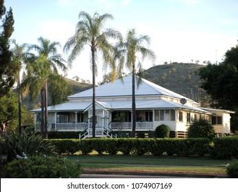 Street scene in Gayndah Queensland with old house and palm trees. Gayndah,  Queensland Australia