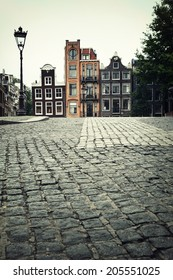 Street scene showing traditional architecture, Amsterdam. Filtered to look like an aged instant photo.