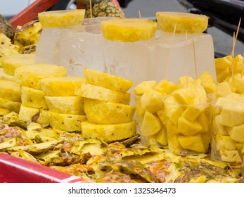 Street sell of fresh topical pineapple at Cali city center