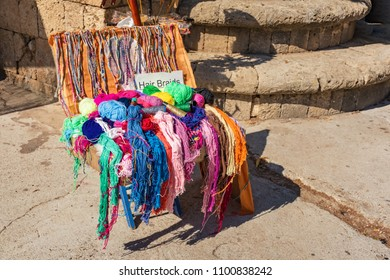 Street selling of colorful cotton / strings in old town in City of Rhodes (Rhodes, Greece)