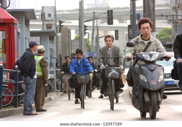 a street of shanghai with a scooter and a bicycle