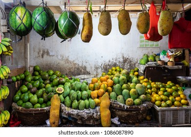 Street shop selling mangoes, watermelon, avocados, oranges and jack fruits in Jakarta, Indonesia