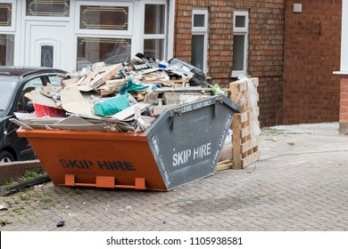 Street side skip filled with rubish