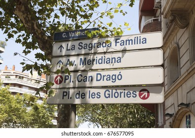 A street sign in Barcelona, Spain, with directions to the Cathedral Sagrada Familia