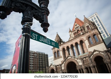 Street sign in Boston, Massachusetts. In background the Trinity Church is visible.