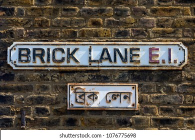 A street sign for Brick Lane in East London, UK.  Brick Lane is also spelt out in the Bengali language on a sign underneath.