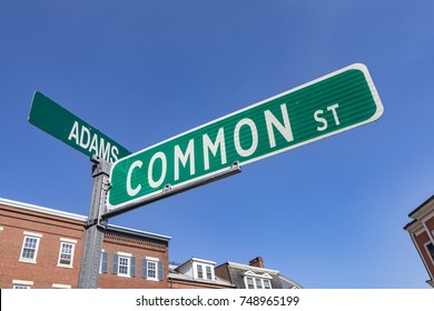 street sign common street and adams street in Boston at a crossing