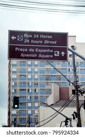 Street Sign in Curitiba, state of Parana, Brazil. Text in portuguese indicates 24h street and Spanish square.