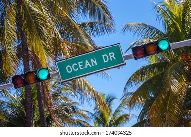 street sign of famous street Ocean Drive in Miami South with traffic light