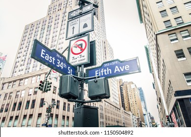 Street sign of Fifth Ave and East 34th street in front of Empire State Building