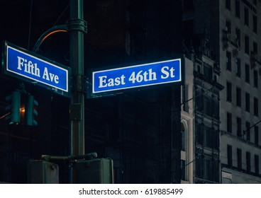 Street sign of Fifth Ave and East 41St with skylines in background.- New York, USA