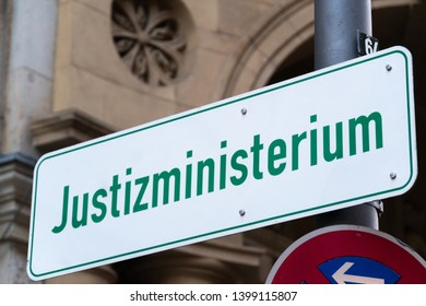 Street sign with the German text Justizministerium (Ministry of Justice)