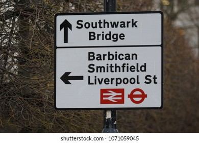 A street sign in London directs traffic towards Southwark Bridge, Barbican, Smithfield and Liverpool Street station.