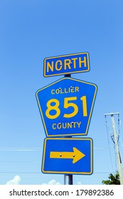 street sign north collier route 851 under blue sky