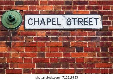 Street sign on british red brick background